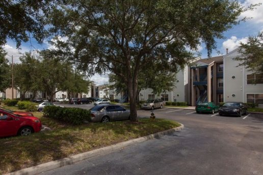 Exterior of Acclaim at Conroy with parking lot and trees