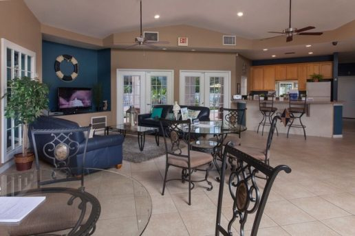 Lounge area with seating, TV, and kitchen area